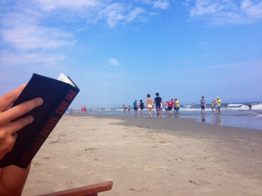 Reading the final chapters of The Doll on the beach.