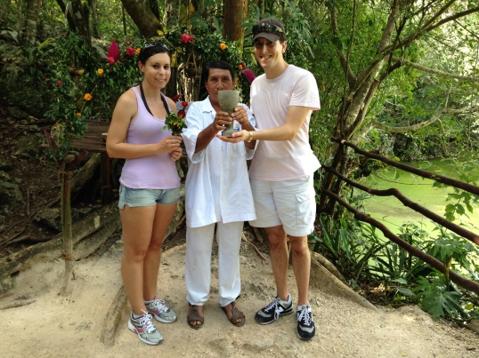 Here's a photo of us with a Shaman after he performed a ceremony asking the spirits to allow us to enter a Mayan cenote.