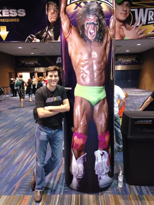 Posing with an oversized version of the Ultimate Warrior at WrestleMania Axxess.