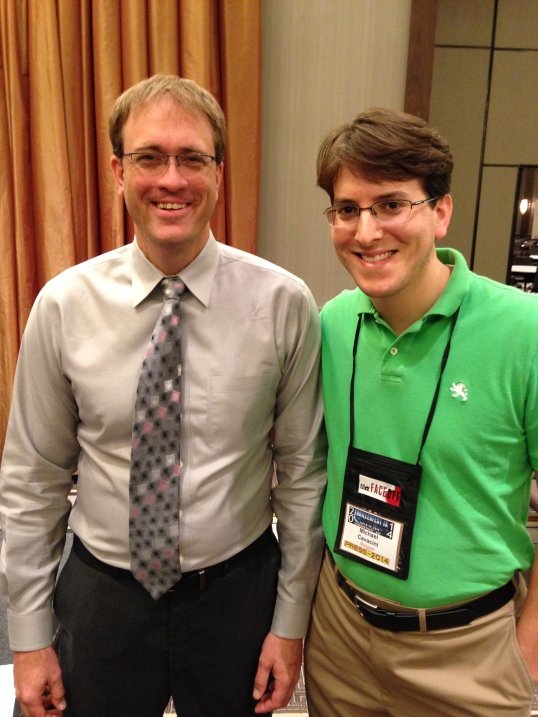 Posing for a photo with my favorite speaker at ThrillerFest: Steven James.