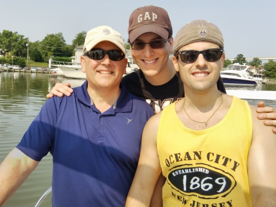 Outdoor photo of me and my family on a boat.