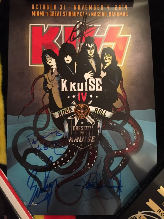 An autographed KISS poster.