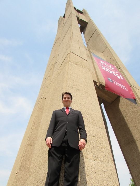 In front of Temple's iconic bell tower.