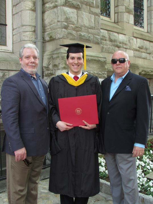 With my Dads after graduation.