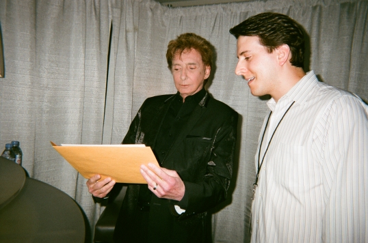 Barry looking at the photo of us together in LA before autographing it.